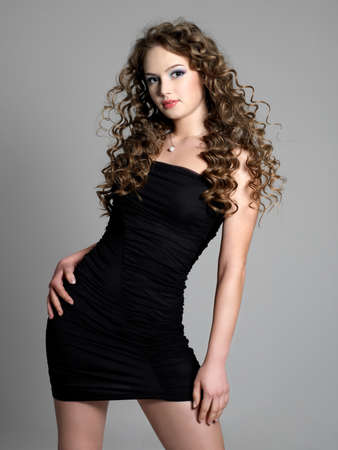 Beautiful young elegance woman in black dress - grey background Stock Photo - 9298001