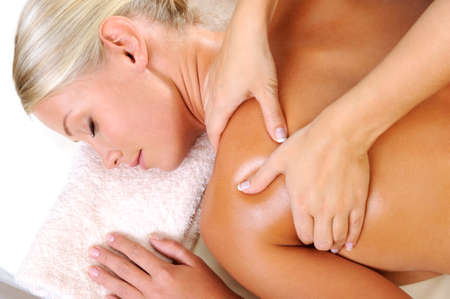 beauty therapy: Relaxing young woman taking massage in beauty salon