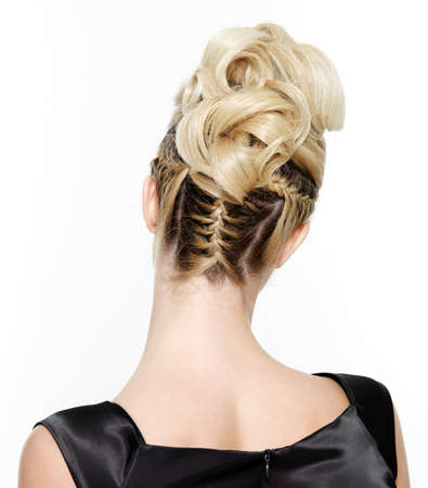 plait: Blond female with creative curly  hairstyle, rear view on white background
