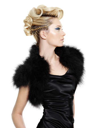 elegancy: Glamour woman in black fur dress with modern  hairstyle posing   on white background