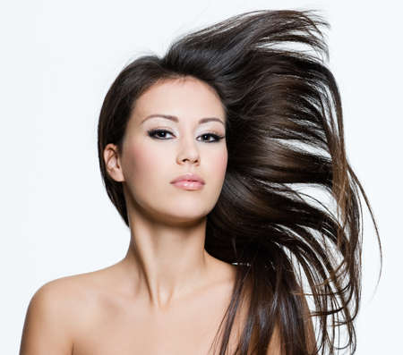 long hairs: Attractive young female with beautiful long brown hairs, posing isolated on white
