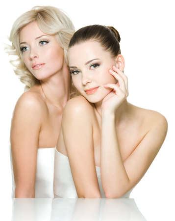 nude pretty girl: Sensuality faces of two beautiful young adult women are together. Girls posing on white background Stock Photo