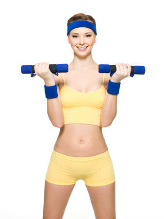 dumbells: Woman doing fitness exercise with dumbbells isolated on white Stock Photo
