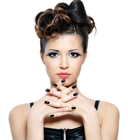 Attracitve  woman with stylish hairstyle and black nails. Fashion eye make-up Stock Photo - 10834898