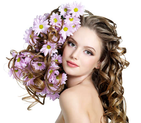 Spring flowers in beautiful long hair of young woman - white background Stock Photo - 10834917