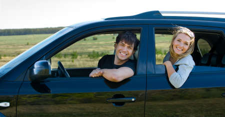 bautiful happy young couple driving the car photo