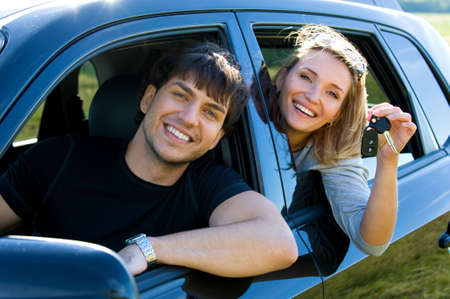 Happy bautiful couple showingh the keys sitting in new car  Stock Photo - 10834892
