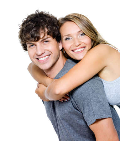 portrait couple: Portrait of a beautiful young happy smiling couple - isolated