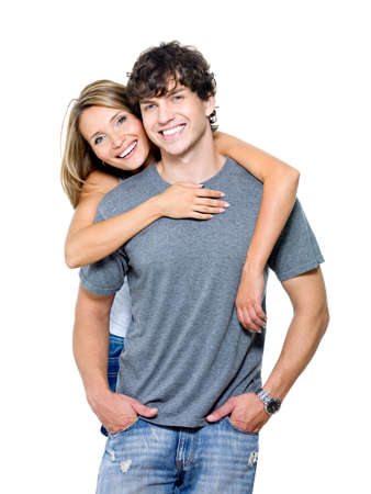 Portrait of a beautiful young happy smiling couple - isolated photo