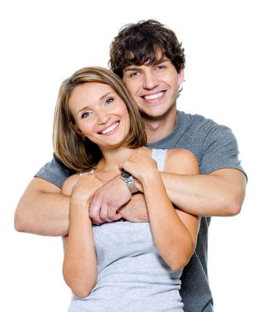 attractive couple: Portrait of a beautiful young happy smiling couple - isolated