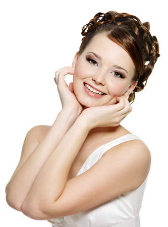 Portrait of the young smiling woman with modern brown make-up and short curly hairs photo
