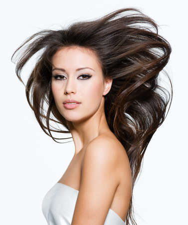 Sensual pretty woman with beautiful long brown hairs, posing isolated on white photo