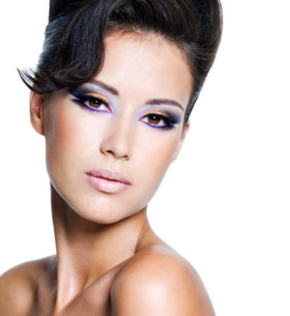 Beautiful face of a glamour woman with modern brightly makeup photo