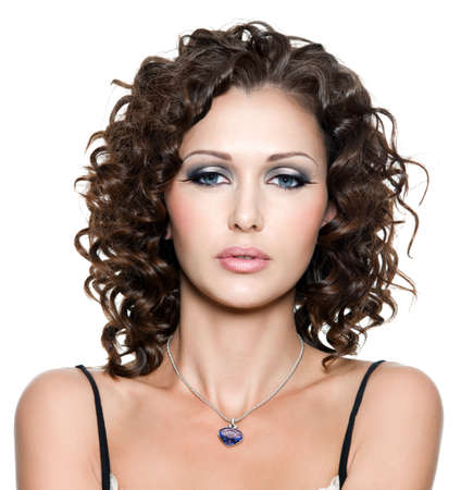 portrait of young beautiful woman with fashion makeup and curly hair. Isolated on white photo