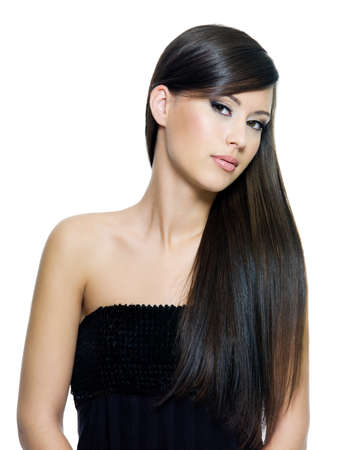 Portrait of beautiful young woman with long straight brown hair posing isolated on white background photo
