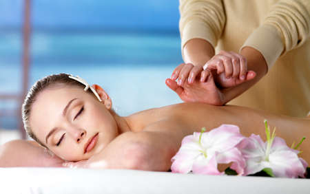 Beautiful woman on spa massage for back  - nature background photo