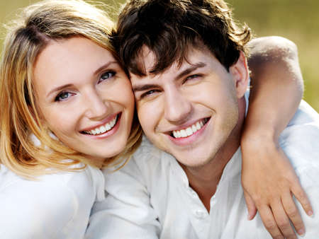 portrait of young happy beautiful couple on nature   Stock Photo - 11172515