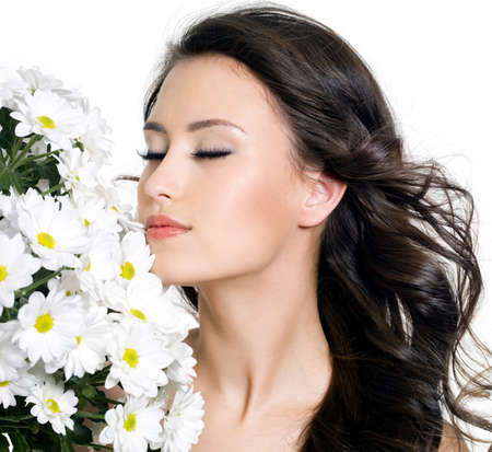 Portrait of beautiful brunette  woman with closed eyes and flowers - white background photo