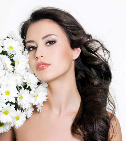 Portrait of young beautiful woman with spring flowers - white background photo