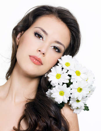 Portrait of beautiful young woman with  flowers - white background photo