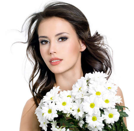 Sensuality beautiful girl with spring bouquet of  flowers - white background photo