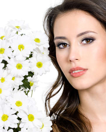 Beautiful fresh face of young woman with white flowers - isolated photo