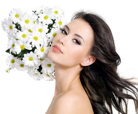 Young beautiful sensual woman with flowers - white background photo