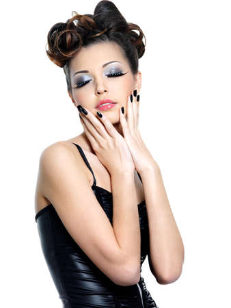 eyeshadow: Young woman with fashion make-up and manicure - isolated on white