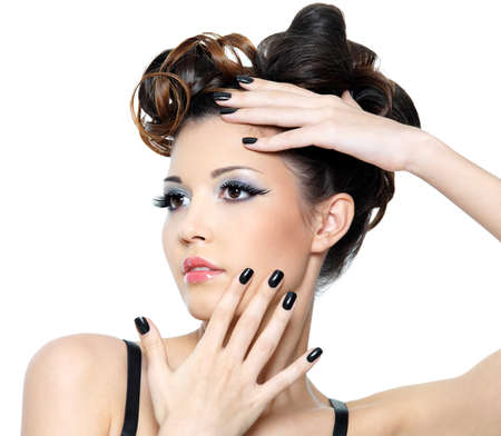 Beautiful glamour woman with stylish hairstyle and black nails. Fashion eye make-up  photo