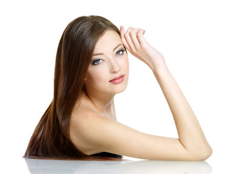 Portrait of young attractive woman with long straight beautiful hair - white background photo
