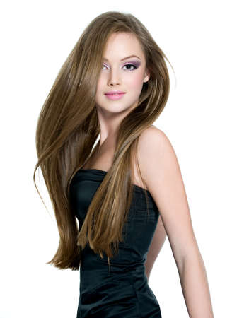Beautiful teen girl with  long straight hair, posing on white background Stock Photo - 12084630