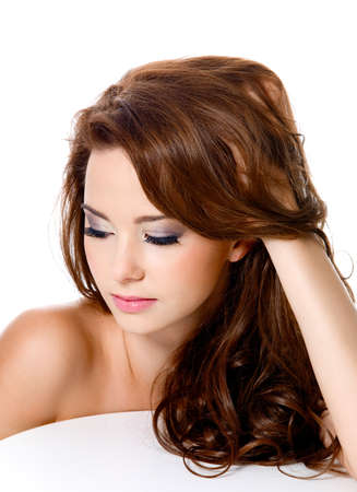 attractive woman with beautiful hairs and fashion makeup - isolated photo