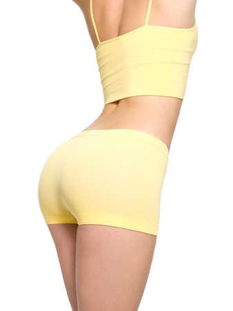 fesse: Jeune femme avec de belles fesses, sportif et taille fine - isol� sur blanc