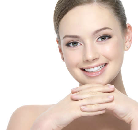 Happy beautiful face of young woman with clean skin - white background Stock Photo