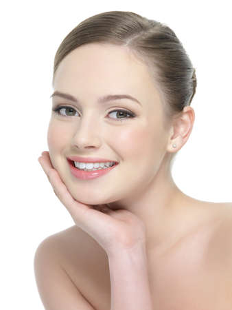 Beautiful portrait of smiling woman with healthy skin - isolated on white photo