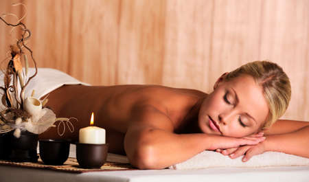 spa treatment: Young beautiful blonde woman get relax in the spa salon Stock Photo
