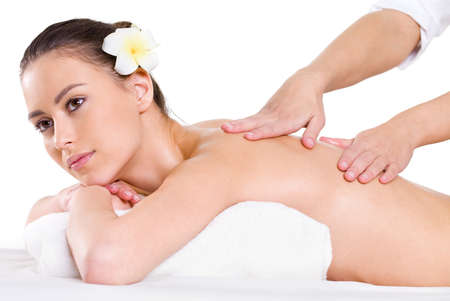 body massage: Young beautiful girl having massage on her back - white background