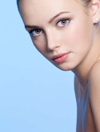 Close-up face of beautiful young woman with fresh skin photo