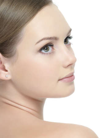 bodycare: Profile of young beautiful face of woman - white background