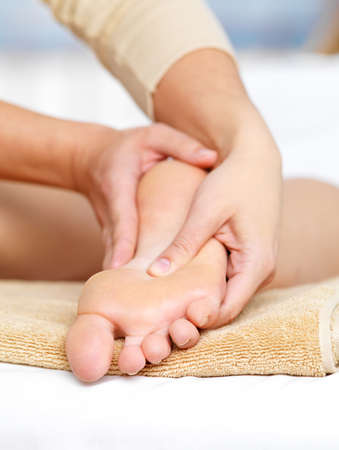 Close-up massage for foot in spa salon - vertical Stock Photo - 12460936