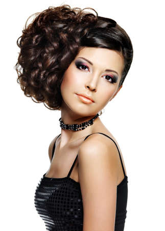 hairdo: Beautiful young woman with fashion hairstyle and glamour makeup - on white background Stock Photo