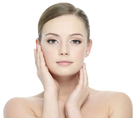 nude woman sexy: Portrait of beautiful girl stroking her pretty face with healthy skin - white background Stock Photo