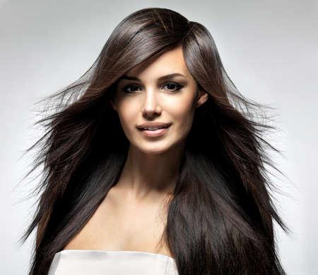Fashion model with long straight hair. Fashion model posing at studio. Stock Photo - 16105104