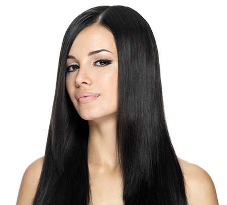 Woman with long straight hair. Fashion model posing at studio.