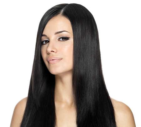 Woman with long straight hair. Fashion model posing at studio.