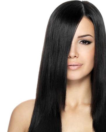 Woman with long straight hair. Fashion model posing at studio. Stock Photo - 16105099