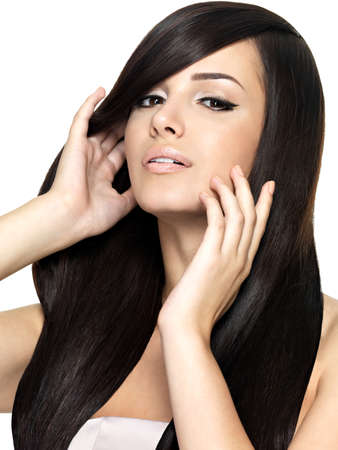 Woman with beauty long straight hair. Pretty young girl with beautiful hairstyle. Creative studio image. photo