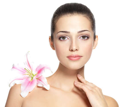 beauty face: Beauty face of young woman with flower. Beauty treatment concept. Portrait over white background