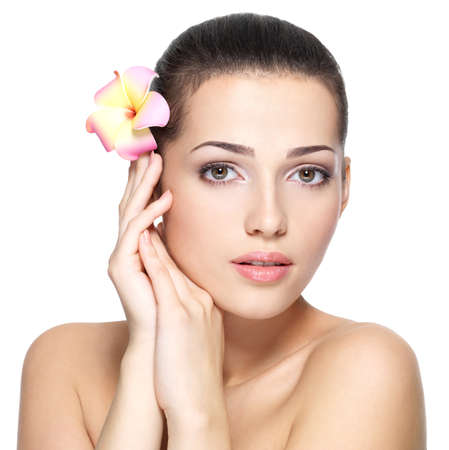 Beauty face of young woman with flower. Beauty treatment concept. Portrait over white background Stock Photo - 16131110