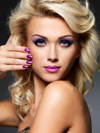 fingernails: Beautiful blond woman with beauty purple manicure and makeup of eyes  Fashion model with curly hairstyle
